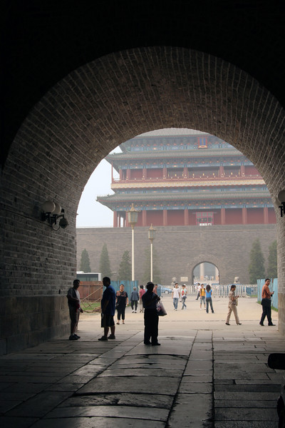 Walking through one of the 9 gates that surround Beijing, looking out at another gate.