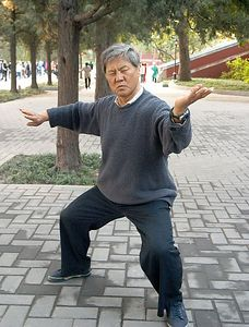 Man practicing tai chi at Bei Hai Park.