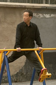 Beijing has many public, outdoor exercise machines.