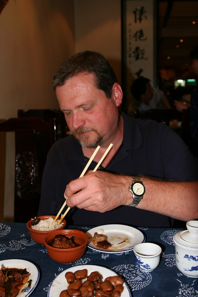 Alan at Kong Yiji restaurant, Houhai, demonstrating that he has been practicing his chopstick skills