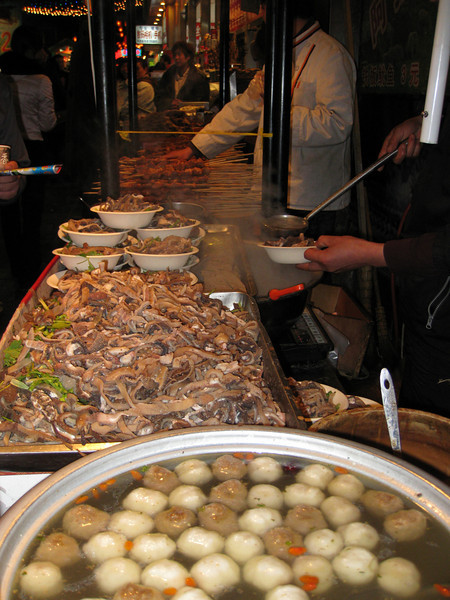 Cooking at the night market. I have no idea what any of these things are. Nor did I eat any of them.