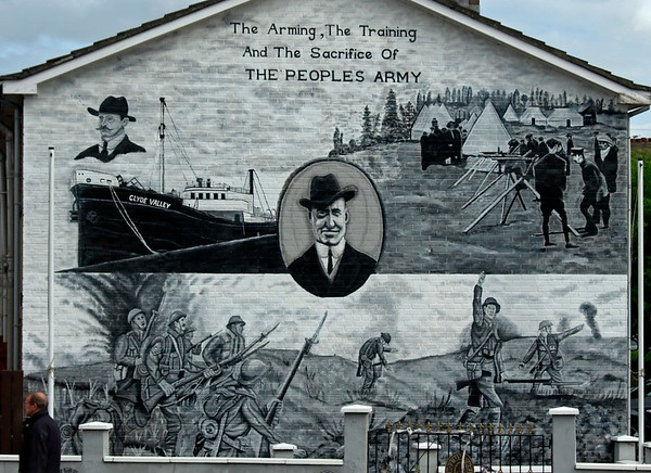 Ulster Volunteer Force mural, Sydenham, Belfast, 7 May 2009.  The paramilitary UVF was formed by loyalists in 1912 when Ireland was on the brink of sectarian civil war over home rule, ie the devolution of government to Dublin.  The UVF subsequently formed the core of the British Army's 36th (Ulster) Divison during the First World War and took part in the 1916 Battle of the Somme as shown in the bottom half of the mural.