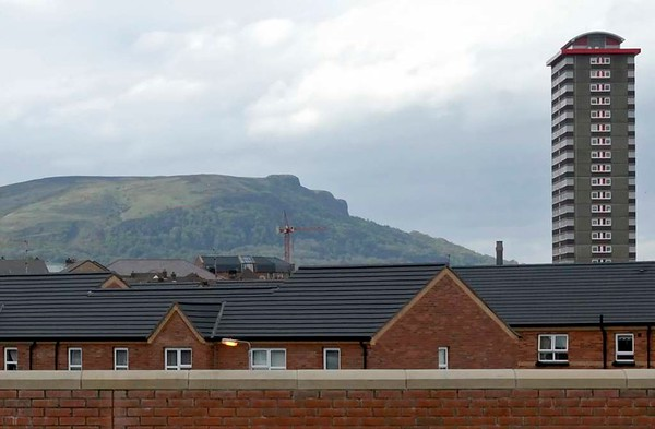Lower Falls from Grosvenor Road, Belfast, 7 May 2009.  Looking north, to Cave Hill and Divis flats.  Much of the housing on the lower Falls and Shankill has been rebuilt on traditional lines.