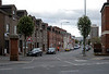 New Lodge Road, Belfast, 7 May 2009.  Looking east from Antrim Road.  As in the lower Falls and Shankill, the housing has been rebuilt on traditional lines.