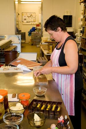 Dinant. Adding walnuts to each chocolate piece.