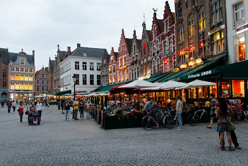 Bruges - evening activity in the sidewalk cafes in Market Square.