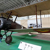 "Brussels - Royal Army & Military History Museum.  One of WW-I Fighters on display in the Museum.  This is a Sopwith Camel I believe.  One point to note regarding this aircraft, is that the twin machine guns would have been equipped with a ""synchronizing mechanism"", as they were firing through the propellor (which is constructed of wood).  Without the synchronizer, the propellor wouldn't last long!"