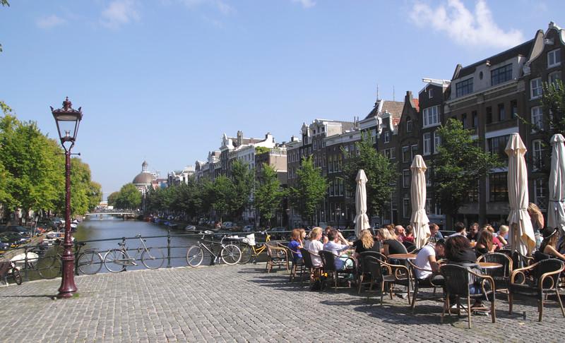 Singel Canal view from Torensluis Bridge Amsterdam Holland