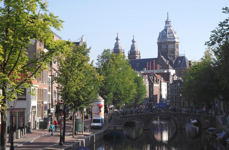 Oudezijds Voorburgwal Canal and Spire of St Nicholas Kerk Amsterdam