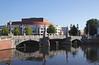 Stadhuis Muziektheatre opera house and Blauwbrug Bridge by Amstel River Amsterdam
