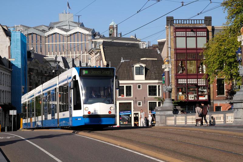 Tram crossing the Blauwbrug Bridge in Amsterdam Holland