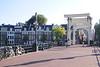 Crossing the Magere Bruge drawbridge Amsterdam Holland
