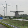 "Netherlands - I thought this view was interesting, as it shows the ""old"" and the ""new"" types of Windmills.  Our tour passed by a LOT of Wind Turbines as well as traditional Windmills."