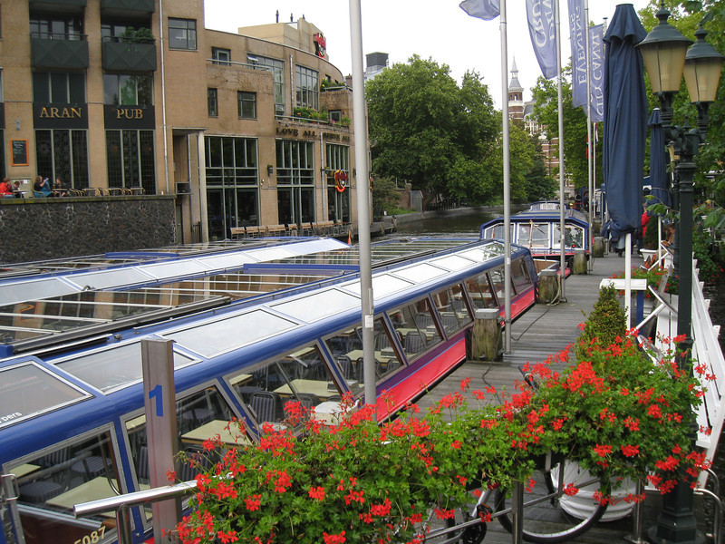 Amsterdam - some of the many canal touring boats at their dock.