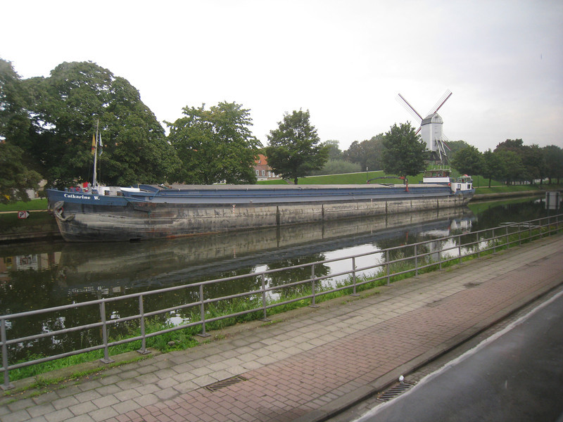 Netherlands - this view provides a glimpse of a Canal boat as well as a Windmill, both a common sight.