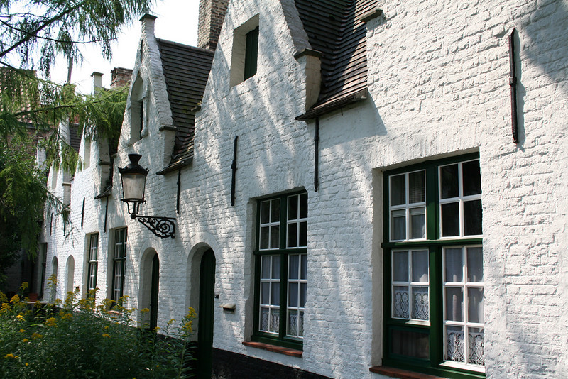 Almshouses--built by the rich, for the poor, in exchange for prayers to help the rich get into Heaven.