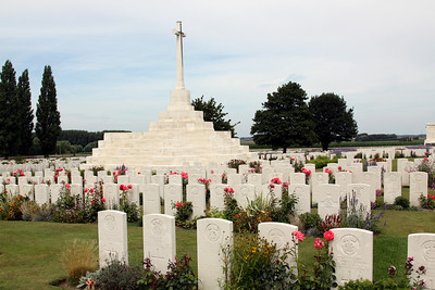 Tyne Cot Cemetery - The Cross of Sacrifice which was built on top of a German pill box in the centre of the cemetery (purportedly at the suggestion of King George V of the United Kingdom, who visited the cemetery in 1922 as it neared completion).