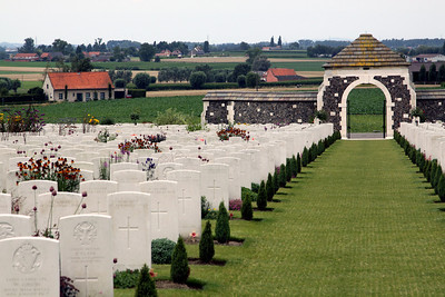 Tyne Cot Cemetery. The cemetery in the middle distance is Dochy Farm Cemetery.