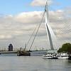 "The Erasmus Bridge was designed by Ben van Berkel and completed in 1996. The 802-metre-long (2,631 ft) bridge has a 139-metre-high (456 ft) asymmetrical pylon, earning the bridge its nickname of ""The Swan""."