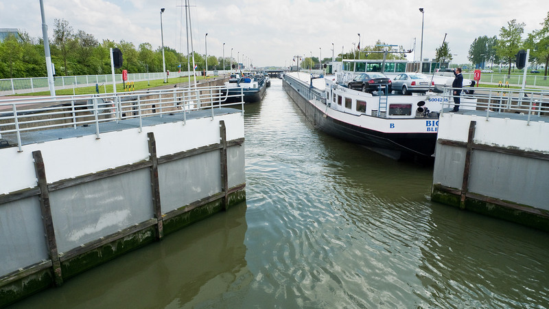 April 28:  At Terneuzen, a series of locks took boats from the West Scheldt, a busy inland waterway, into the canal and river system.  Here, the locks are closing behind a line of boats that will emerge at the other end at a different level.