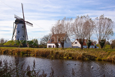 A windmill by the canal