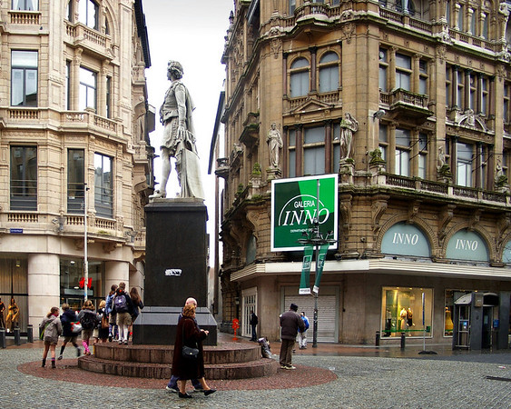Antwerp. To Each His Own. Three lots of people going their own way around this statue in the centre of Antwerp.