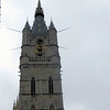 "This is the Belfort, or Belfry--the first of Ghent's ""Three Towers.""  It is a UNESCO World Heritage site.  It is 299 feet tall, built in the 14th century (except for the spire, which was built in the 20th century using 14th century designs).  It is located between City Hall and St. Bavo's Cathedral.  According to Rick Steves, it was originally built to house and protect the parchment record of Ghent's favored privileges, granted to the city by the counts of Flanders in exchange for financial support.  It also served as a fire watchtower.    It has a 54 bell carillon which sometimes gives concerts.  One can go up in the tower for an aerial view of the city."