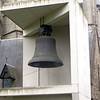 This bell is called the Great Triumphant, or, I think, the Roeland Bell.  Its history is a little complicated.  It was made in the 14th century to hang in the Belfry, but was resmelted in the 17th century.  Then in the early 20th century it developed a crack and had to be removed.  After being moved around to several different places, it came to rest here in front of the church in this sort of concrete shelter.  The original bell weighed 12,000 pounds.