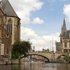 A view of historic buildings and bridges from a boat tour in Ghent, Belgium.