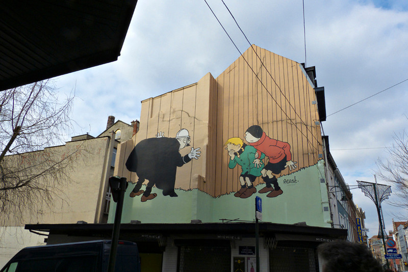 "drawing of Herge, famous for this ""Tintin"" books, along Rue Haute"