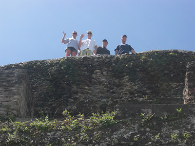 "Stacy, Dan, Andrew and Rick at the top of one of the Mayan ruins at Xunantunich (""Stone Lady"")."