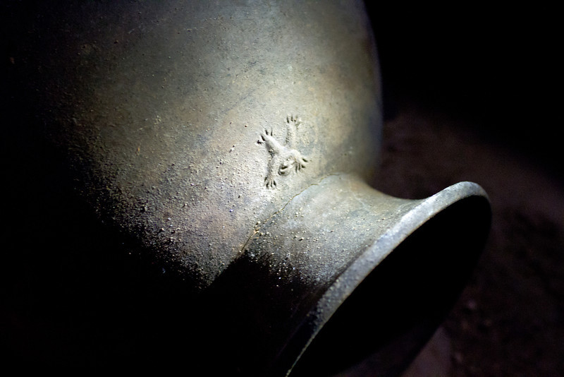 This intact pot from the ATM cave theoretically offers the mark of the maker.  It has variously been described as a bird or a monkey but fits neither description well.