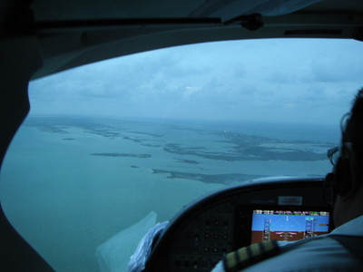 © Joseph Dougherty.  All rights reserved.   Flying into San Pedrol on Ambergris Caye on Tropic Air....  planes small enough that a big dog might view them as a chew toy.