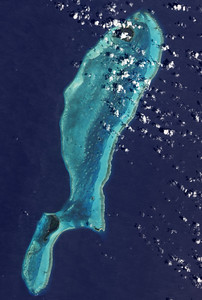 Lighthouse Reef Atoll as seen from space.    The Great Blue Hole is near the center of the atoll.  NASA public domain image.