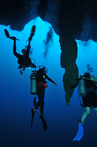 © Joseph Dougherty.  All rights reserved.   Stalactites and divers in the Great Blue Hole at 130 feet; Lighthouse Atoll, Belize.