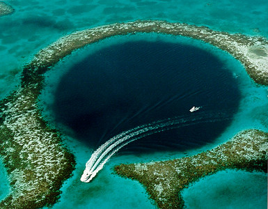 The Great Blue Hole, Lighthouse Reef Atoll, Belize.  U.S. Geological Survey (USGS) public domain image.