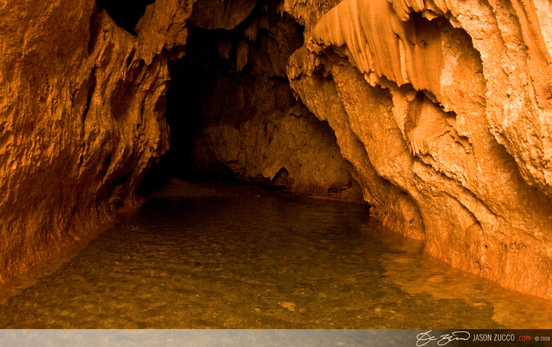 Actun Tunichil Muknal Cave.  Much of the hike into this cave is through water, sometime of which can be up to 15ft deep.