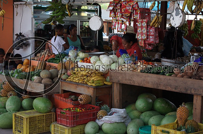 The farmers market Belizean style! I really like the look of determination on the woman's face wielding the knife!  San Ignacio, Belize.
