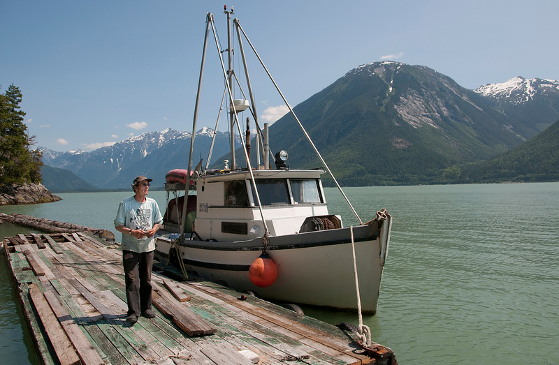 Captain Fred Dorsey and his fishing boat. He fishes for salmon once per week, alone. He sells his typical catch for about CDN$2,500.