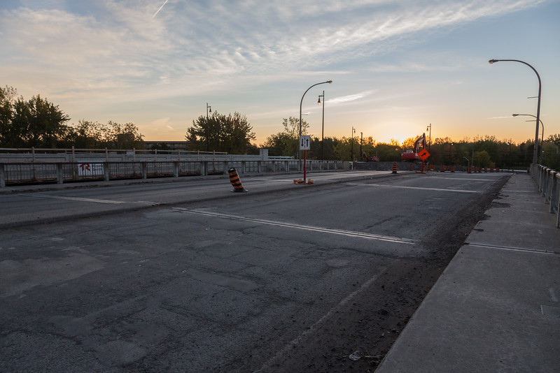 New bridge over Canadian Pacific tracks on Bay Bridge Road opened 2016 October 14th. Not quite complete, final work includes demolition of old bridge which will allow for all lanes to be used. Old bridge surface.