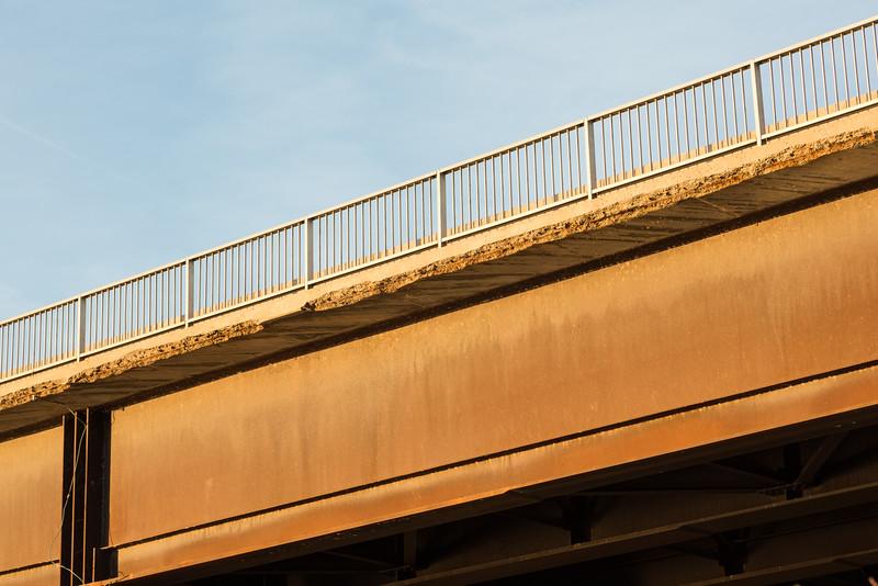 Eroding concrete at edge of walkway on the Norris Whitney bridge.