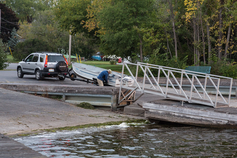 Man preparing to launch boat at Herchimer Avenue boat ramp in Belleville.