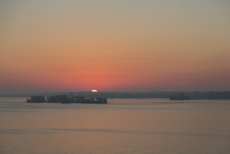 Sunrise down the Bay of Quinte from the Norris Whitney bridge. Darker view.