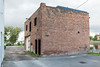 194R Front Street, building along the Moira River behind buildings on Front Street.