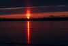 Sunrise across the Bay of Quinte at Belleville Ontario. Sun pillar. Dark exposure.