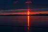 Sunrise across the Bay of Quinte at Belleville Ontario. Sun pillar.