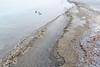 Sandy water rolling in.