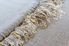 Sand laden water coming in.