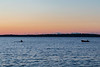 Rower and chase boat on the Bay of Quinte before sunrise 2018 September 24.