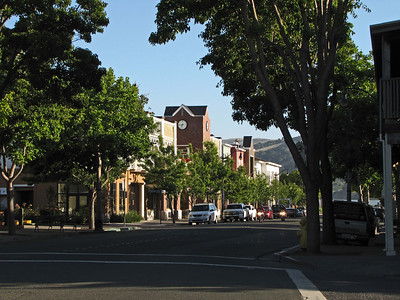 Main Street, Benicia, California, looking south. The clock shows 6:45 PM; the long shadows show it is very near midsummer.